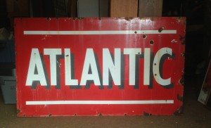 We buy vintage advertising signs
